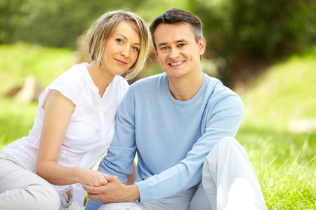 Portrait of young amorous couple looking at camera in park Stock Photo - 10203899