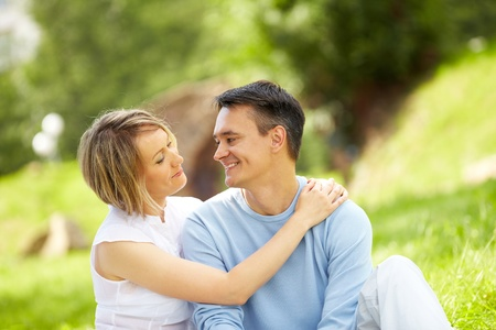 Portrait of young amorous couple looking at each other in park Stock Photo - 10203480