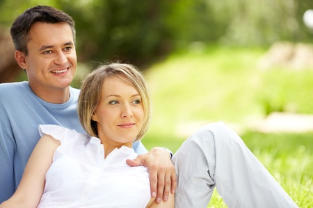 springtime: Portrait of young amorous couple looking straight outdoors