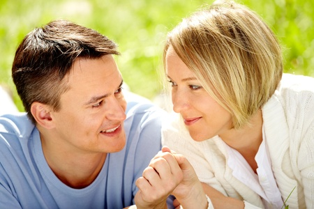 Portrait of amorous couple looking at each other with smiles Stock Photo - 10203494
