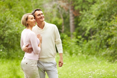 Portrait of young happy couple enjoying wonders of nature photo