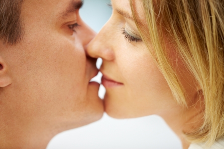 Close-up of young happy couple kissing photo
