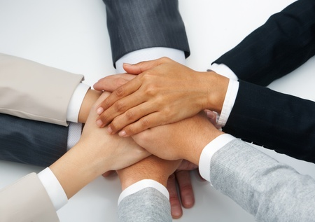 collaboration team: Image of business people hands on top of each other symbolizing partnership Stock Photo