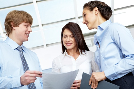 Photo of confident employees discussing plans at meeting  photo