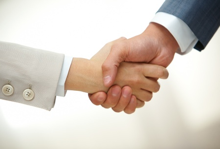 Photo of handshake of business partners after signing contract photo