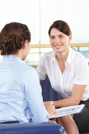 Portrait of confident businesswomen consulting in office Stock Photo - 10251491