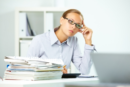 Portrait of smart businesswoman thinking at work in office Stock Photo - 10289770