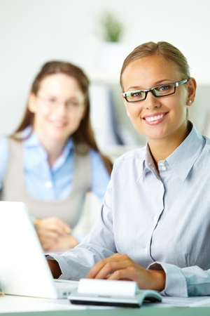 Portrait of pretty secretary looking at camera while working Stock Photo - 10289749