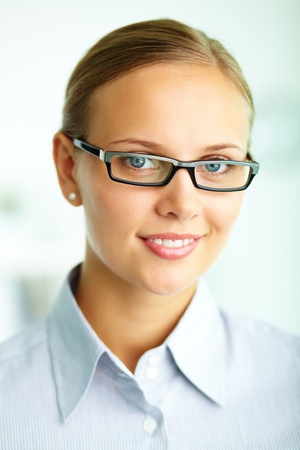 Portrait of elegant businesswoman in eyeglasses looking at camera photo