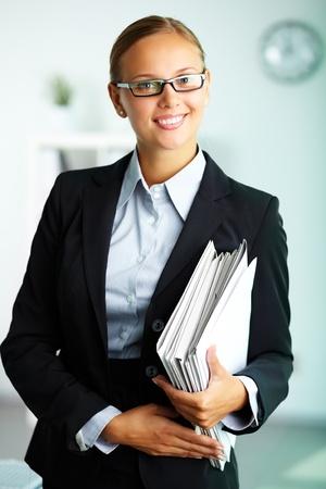 Portrait of elegant businesswoman looking at camera photo