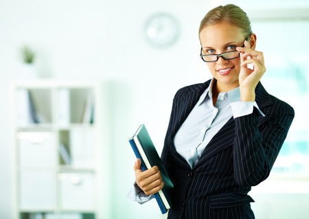 Portrait of confident businesswoman looking at camera in office Stock Photo - 10289694