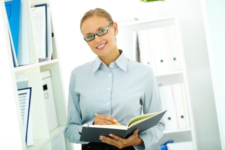 Portrait of happy businesswoman looking at camera in office Stock Photo - 10289713