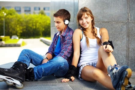 teen couple: Couple of happy teens spending free time outside Stock Photo