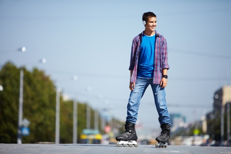 roller skate: Image of happy teenager on roller skates in the city Stock Photo