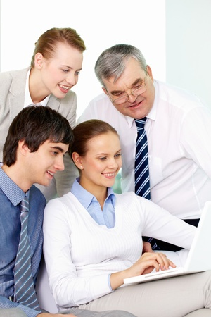 Portrait of several colleagues working through internet in office Stock Photo