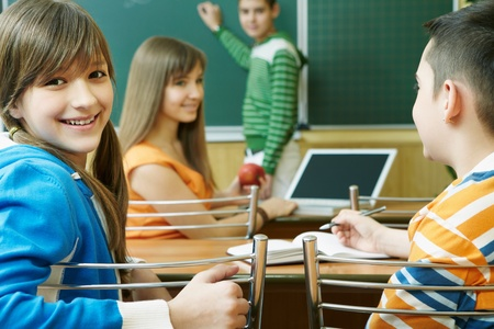 Confident student looking at camera during lesson photo