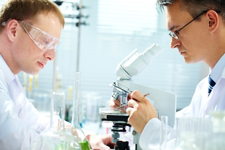 clinical research: Portrait of two male chemists researching in laboratory