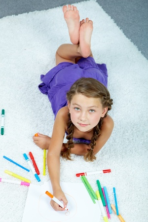 pretty little girl: Portrait of lovely girl drawing with colorful pencils Stock Photo