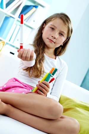 junior: Portrait of lovely girl holding colorful pencils
