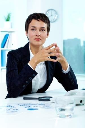 principal: Photo of smart businesswoman sitting in office Stock Photo