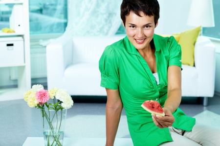 Photo of young woman with piece of watermelon looking at camera Stock Photo - 10378456