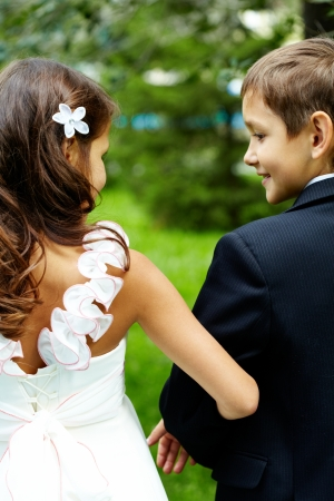 Rear view of children bride and groom on wedding  photo