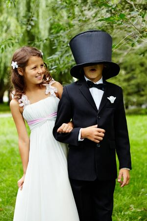 child couple: Portrait of funny children bride and groom on wedding  Stock Photo