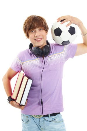 young fellow: Portrait of teenage boy with books, headphones and ball looking at camera Stock Photo