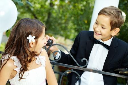 Portrait of girl bride surprisingly looking at her groom Stock Photo - 10445994