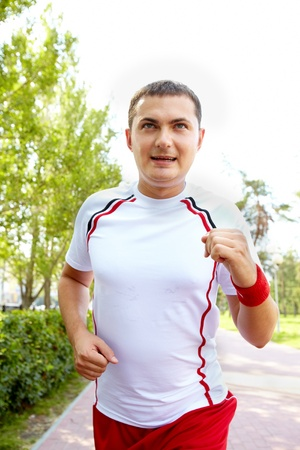 Image of young sportsman running on summer day Stock Photo - 10446063