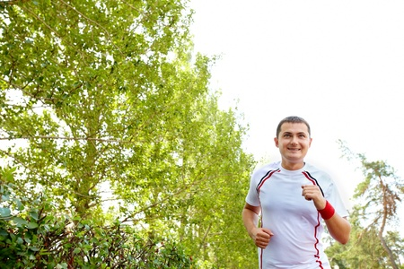 Image of positive sportsman running on summer day Stock Photo - 10446088