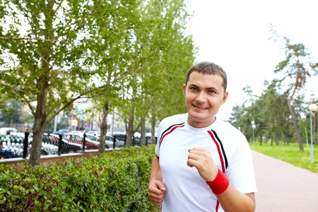 Image of positive sportsman running on summer day Stock Photo - 10446065