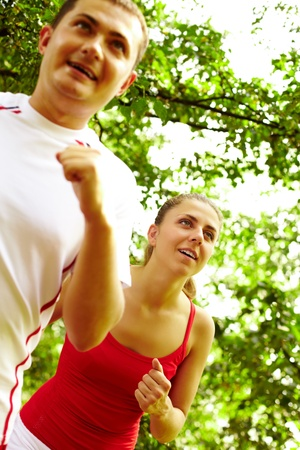 Image of happy young female running with boyfriend near by Stock Photo - 10446091