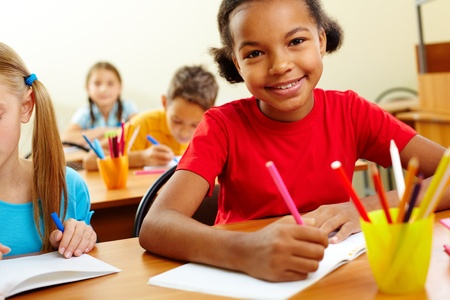 multiracial children: Portrait of lovely girls looking at camera at lesson