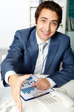 Portrait of a successful employer looking at camera while giving his hand for handshake Stock Photo - 10446141