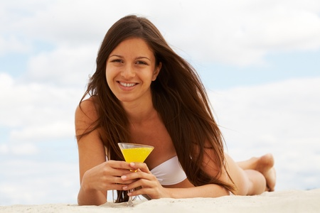 Image of female with martini looking at camera on sandy beach Stock Photo - 10446101
