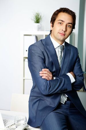 Portrait of a successful employer in formalwear looking at camera Stock Photo - 10446140