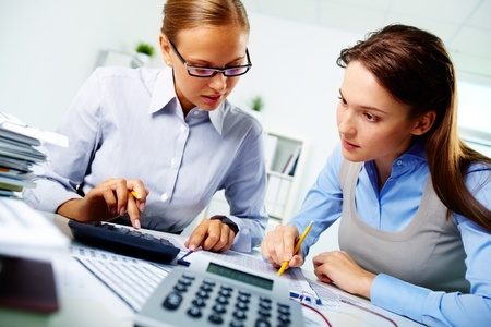 group  accountant: Portrait of two businesswomen working with papers in office Stock Photo