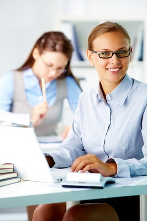 Portrait of pretty secretary looking at camera while working Stock Photo - 10490911