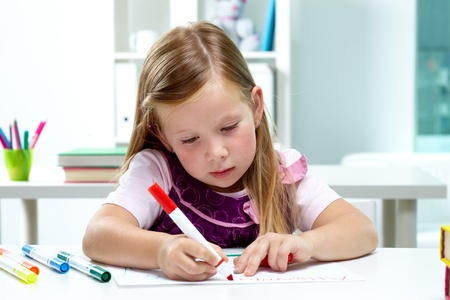 children painting: Portrait of lovely girl drawing with colorful pencils Stock Photo