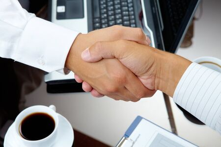 handshaking: Photo of handshake of business partners after striking deal
