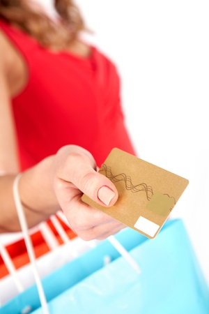 charge: Close-up of woman's hand holding plastic card and giving it to shop assistant