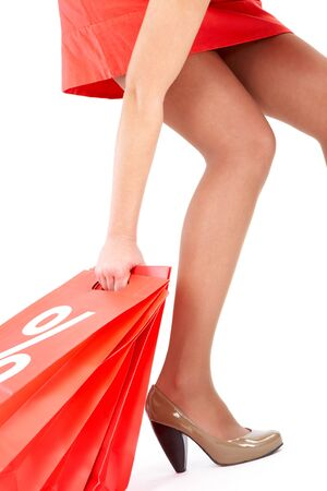 Leg and arm of lady carrying red paper bags Stock Photo - 10503888