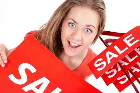 shopaholics: Portrait of amazed shopper with sale tags looking at camera  Stock Photo