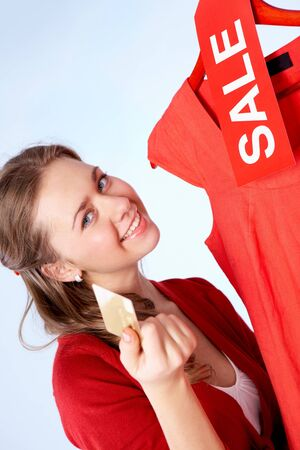 Portrait of happy woman with credit card on sale  photo