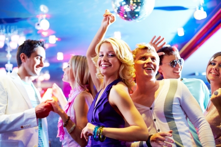 Portrait of cheerful girls and guys dancing at party Stock Photo - 10546540