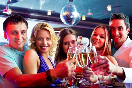 Portrait of boozing people in smart clothes toasting at party photo