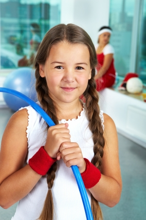 girl in sportswear: Portrait of healthy girl with blue hoop in gym