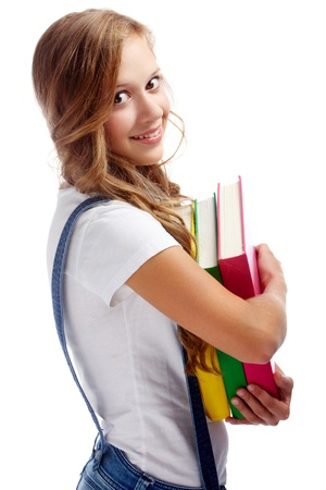 youthful: Cute girl with several books smiling at camera in isolation Stock Photo