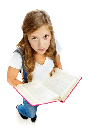 Cute girl holding open book and looking at camera in isolation Stock Photo - 10562659